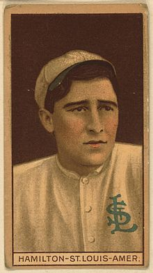 "A sepia-toned baseball card image of a man in a white baseball uniform with an interlocking ""StL"" on the left breast"