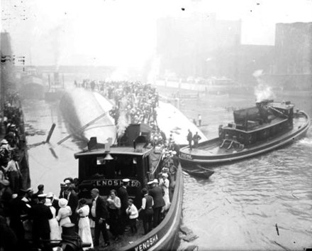 Passengers being rescued from the hull of the Eastland by the tugboat Kenosha in the Chicago River EastlandKenosha.jpg