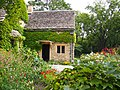English Limestone Cottage with Garden in full bloom (9712009894).jpg