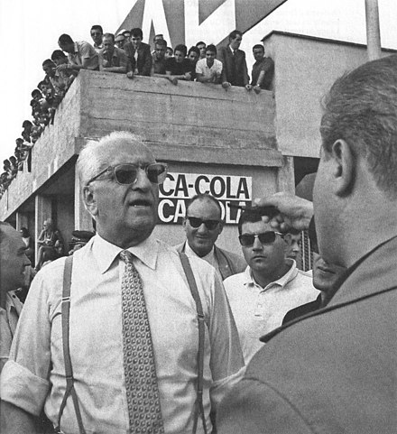 Enzo Ferrari speaks with reporters during the weekend of the 1967 Italian Grand Prix Enzo Ferrari - Monza, 1967.jpg