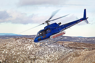 Air travel - A Eurocopter AS350B helicopter in flight