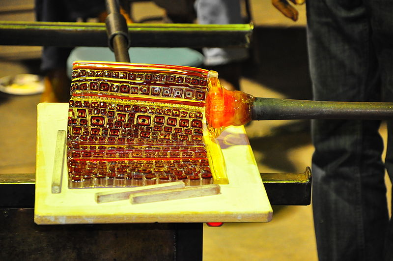 File:Example of picking up murrine onto a blowpipe while blowing glass.JPG