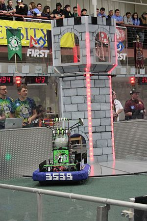 FIRST Stronghold - A robot getting ready to shoot a boulder into the high goal