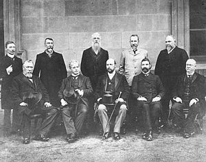 Australian federal election, 1901 - Edmund Barton is seated second from the left, surrounded by the Federal Executive Council, comprising his Cabinet ministers and the Governor-General, Lord Tennyson. Standing at the rear, left to right are James Drake, Senator Richard O'Connor, Sir Philip Fysh, Charles Kingston, and Sir John Forrest. Seated at the front, left to right are Sir William Lyne, Edmund Barton, Lord Tennyson, Alfred Deakin, and Sir George Turner.