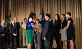 First Lady Michelle Obama shakes hands with Al Almanza, administrator of the Food Safety and Inspection Service (FSIS) while visiting the U.S. Department of Agriculture (USDA).jpg
