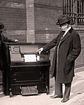 Edwin S. Votey (right) with the player piano