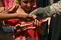 Flickr - DVIDSHUB - U.S. Soldier hands out candy to Iraqi Children.jpg