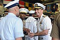 Flickr - Official U.S. Navy Imagery - The CNO gives coins to reenlistees in the hangar bay of USS Wasp..jpg