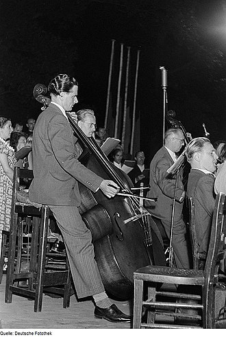 Bassline - A German double bass section in 1952. The player to the left is using a German bow.
