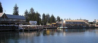 Locals and tourists travel to the Fremantle Fishing Boat Harbour for seafood Fremantle Fishing Boat Harbour.jpg