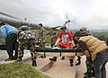 French and Polish Rescue team with Nepalese Army are boarding quake affected injured persons on an IAF Helicopters, in Melanchi, Nepal (1).jpg