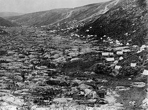 Mining in New Zealand - Gold rush tents and digs in Gabriel Gully, Clutha District, Otago, 1862.