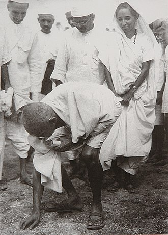 Tax resistance - Gandhi making salt and disobeying the British salt production and tax laws.