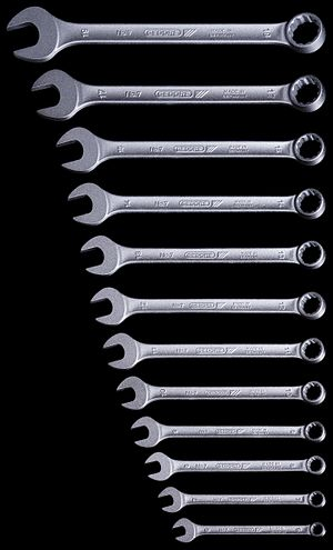 "Wrench - A set of metric spanners or wrenches, open at one end, box/ring at the other. A type like this is commonly known as a ""combination"" spanners."