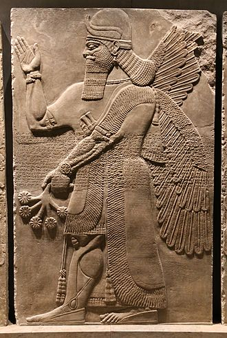 "Assyrian sculpture - ""Winged genie"", Nimrud c. 870 BC, with inscription running across his midriff."
