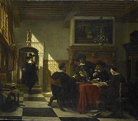 Gezelschap in 17e-eeuwse dracht bij een tafel waarop een Nautilusbeker