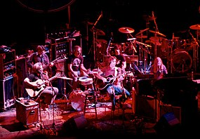 An acoustic performance at the Warfield Theatre in San Francisco in 1980. Left to right: Garcia, Lesh, Kreutzmann, Weir, Hart, Mydland. The Grateful Dead ...