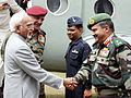 HAMID ANSARI BEING RECEIVED BY LIEUTENANT GENERAL R K SWAMY.jpg