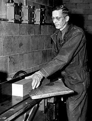 Chicago Pile-1 - Augustus Knuth joints a wooden block for the timber frame