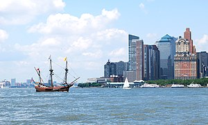 Pavonia, New Netherland - The replica Half Moon at mouth of the Hudson River approaching Lower Manhattan, site of New Amsterdam, with Hoboken, part of Pavonia, in background at left