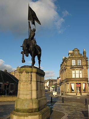 "Teribus ye teri odin - The equestrian monument in Hawick, commemorating the defeat of an English raiding party in 1514, and bearing the motto ""Teribus Teriodin""."