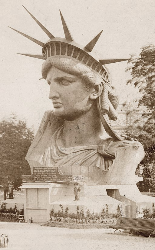 Head of the Statue of Liberty on display in the park Champ-de-Mars in Paris