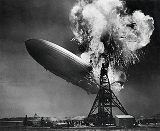 Hindenburg disaster - The stern of the Hindenburg begins to fall, with the mooring mast in the foreground.