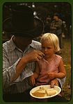 Homesteader feeding his daughter at the Pie Town 1a34142v.jpg