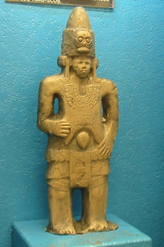 "Huastec people - Replica of statue located in Metro Bellas Artes in Mexico City. The accompanying plaque translates to ""MASCULINE FIGURE – Huasteca Culture – Early Post Classic – Description: From Naranjo, Veracruz. Possible representation of Quetzalcoatl wearing a conical cap with a skull in front and long earflaps, characteristic elements of the Huastec."""