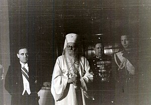 Patriarh Nicodim (centre), with Mihai I (right) and Gheorghiu-Dej (left) at a reception at the Soviet embassy, 1946 IICCR FA147 Dej Nicodim Mihai I reception.jpg