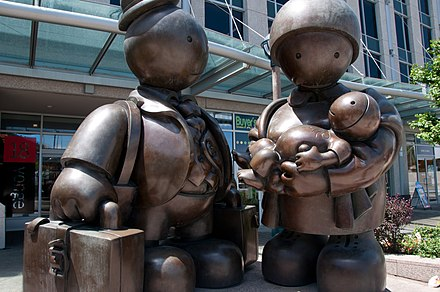 A monument commemorating the immigrant family in Toronto. The province saw a large number of migrants settle in Ontario in the decades following World War II. Immigrant Family Toronto.jpg