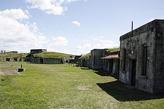 Fort Lytton - The fort consists of almost a hectare of buildings, gunpits, tunnels and other structures embedded in a pentagonal earth mound wall, surrounded by a water-filled moat.