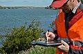 Inspecting a Sacramento River levee (8598950048).jpg