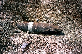 Unexploded ordnance - Extremely corroded Iraqi artillery shell dating from the Gulf War of 1991. Live and dangerous.