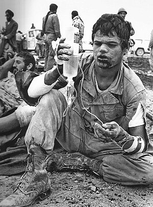 Iran–Iraq War - Iranian soldier holding an IV bag during the Iran–Iraq War