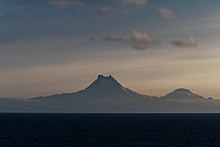 Isanotski (8104ft, 2470m) and Roundtop (6128ft, 1871m) volcanoes as seen from the Unimak Pass in morning light.
