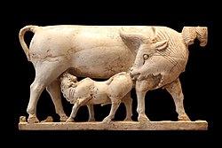 Plaque: calf feeding on its mother's milk