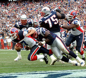 2006 Buffalo Bills season - Bills QB J. P. Losman gets tackled by New England's Ty Warren for a safety, week 1.