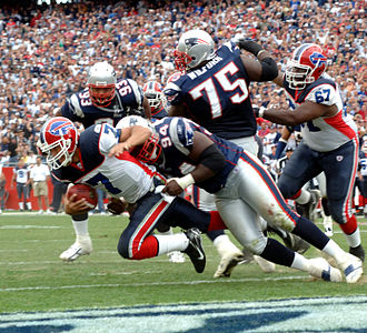 2006 Buffalo Bills season - Bills QB J. P. Losman gets tackled by New England's Ty Warren for a safety, week 1.