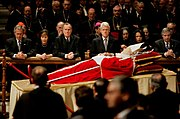Bush, along with George W. Bush, Laura Bush, Bill Clinton, Condoleezza Rice, and Andrew Card pay their respects to Pope John Paul II before the pope's funeral, 2005