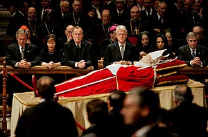 Post-presidency of Bill Clinton - Clinton, along with George W. Bush, Laura Bush, George H. W. Bush, Condoleezza Rice, and Andrew Card pay their respects to Pope John Paul II before the pope's funeral.