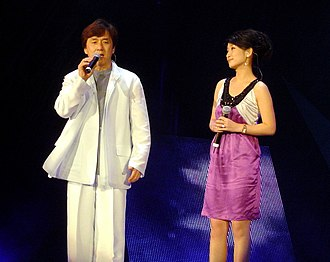 Jackie Chan - Chan and Qin Hailu singing in Shanghai, China in August 2006.