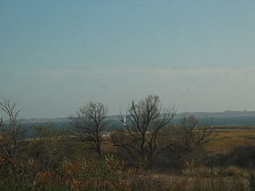 Flat land with open bay behind
