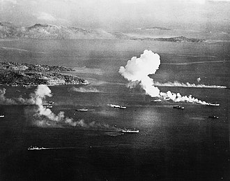 Operation Hailstone - Japanese ships burning off Dublon Island, Truk Lagoon, on the first day of air strikes conducted as part of Operation Hailstone
