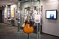 "John Lennon's missing 1962 Gibson J-160E guitar in the exhibit - ""Ladies and Gentlemen... the Beatles!"" exhibit at LBJ Presidential Library, Austin, TX, 2015-06-12 11.37.55.jpg"