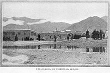 Early photograph of Jokhang behind a small body of water