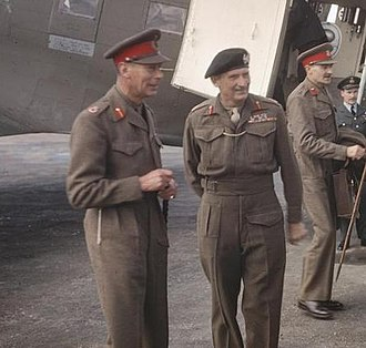 George VI (left) with Field Marshal Sir Bernard Montgomery (right), near the front lines in the Netherlands, October 1944 King George VI with Sir Bernard Montgomery.jpg