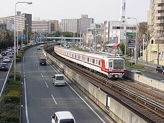 Kita-Osaka Kyuko Railway - Kita-Osaka Kyuko 8000 series train (between Momoyamadai Station and Senri-Chūō Station)