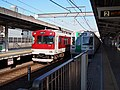 Kyoto SUbway 10 series Kintetsu 3200 series at Takeda Station 2013-12-14.jpg