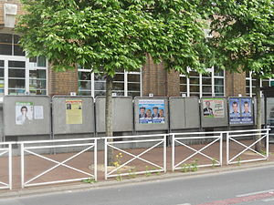 French legislative election, 2012 - Official campaign posters in the 5th constituency of Val-de-Marne. (One of the posters has been partly torn off: a not infrequent occurrence.)